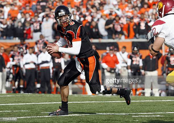 Matt Moore of the Oregon State Beavers runs with the ball during the game against the Southern California Trojans at Reser Stadium on October 28,...
