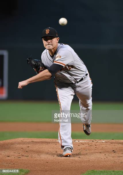 Matt Moore of the San Francisco Giants delivers a warm up pitch during the first inning against the Arizona Diamondbacks at Chase Field on April 5...