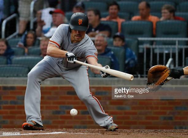Matt Moore of the San Francisco Giants lays down a sacrifice bunt in the third inning against the Atlanta Braves at SunTrust Park on June 20 2017 in...