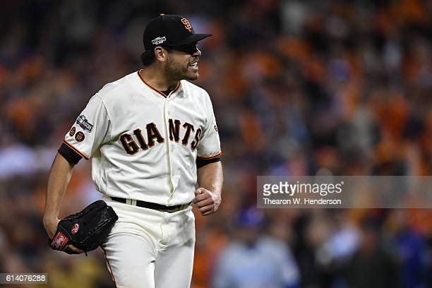 Matt Moore of the San Francisco Giants reacts after the top of the eighth inning of Game Four of their National League Division Series against the...