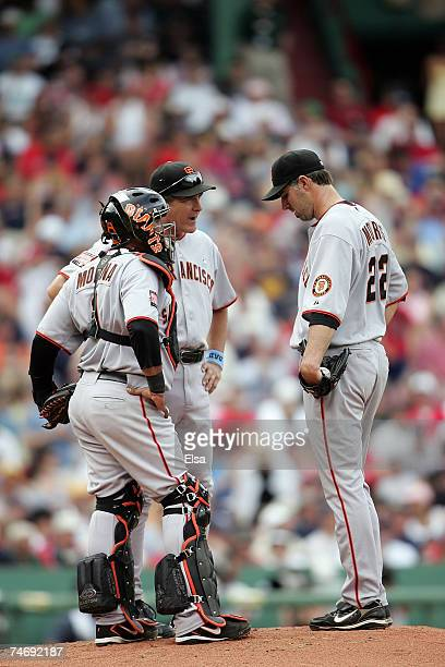Matt Morris of the San Francisco Giants has a conference with catcher Bengie Molina and pitching coach Dave Righetti in the third inning against the...