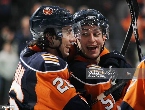 Matt Moulson and Frans Nielsen of the New York Islanders celebrate their win over the Florida Panthers at the Nassau Coliseum on January 21 2010 in...