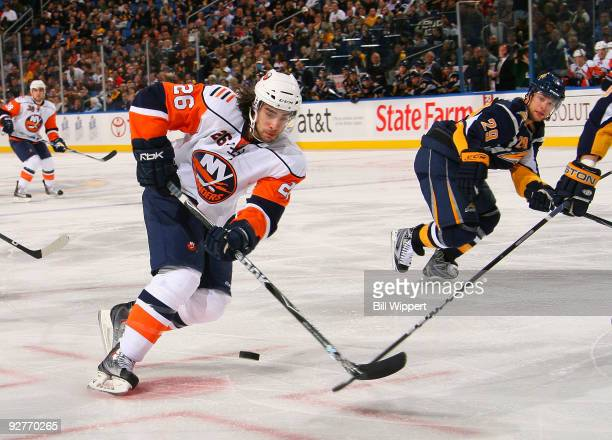 Matt Moulson of the New York Islanders controls the puck against Jason Pominville of the Buffalo Sabres on November 4, 2009 at HSBC Arena in Buffalo,...