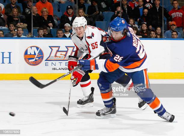 Matt Moulson of the New York Islanders fires a shot past Jeff Schultz of the Washington Capitals on January 20 2011 at Nassau Coliseum in Uniondale...