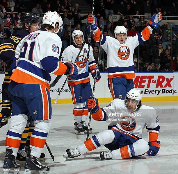 Matt Moulson of the New York Islanders scores a goal at 115 of the second period against the Buffalo Sabres at the Nassau Coliseum on January 23 2011...