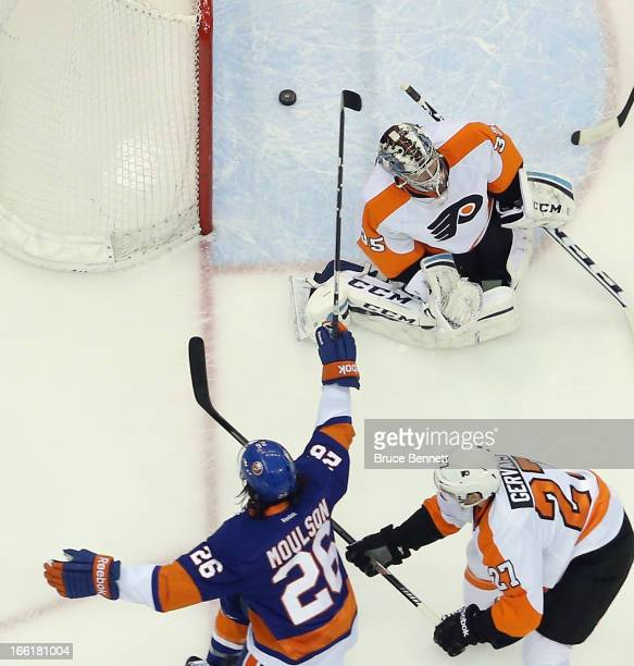 Matt Moulson of the New York Islanders scores at 1536 of the first period against Steve Mason of the Philadelphia Flyers at the Nassau Veterans...