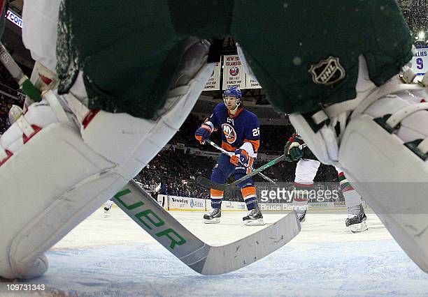 Matt Moulson of the New York Islanders skates against Niklas Backstrom of the Minnesota Wild at the Nassau Coliseum on March 2 2011 in Uniondale New...