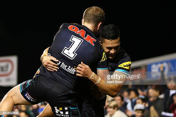 Matt Moylan Dean Whare and Dallin WateneZelezniak of the Panthers celebrate a try by Dallin during the round 26 NRL match between the Penrith...