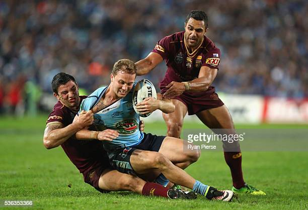 Matt Moylan of the Blues is tackled during game one of the State Of Origin series between the New South Wales Blues and the Queensland Maroons at ANZ...
