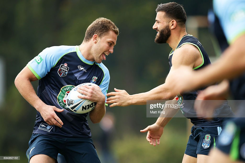 Matt Moylan of the Blues (L) runs the ball at Josh Mansour of the Blues (R) during a New South Wales State of Origin media opportunity on May 26, 2016 in Coffs Harbour, Australia.