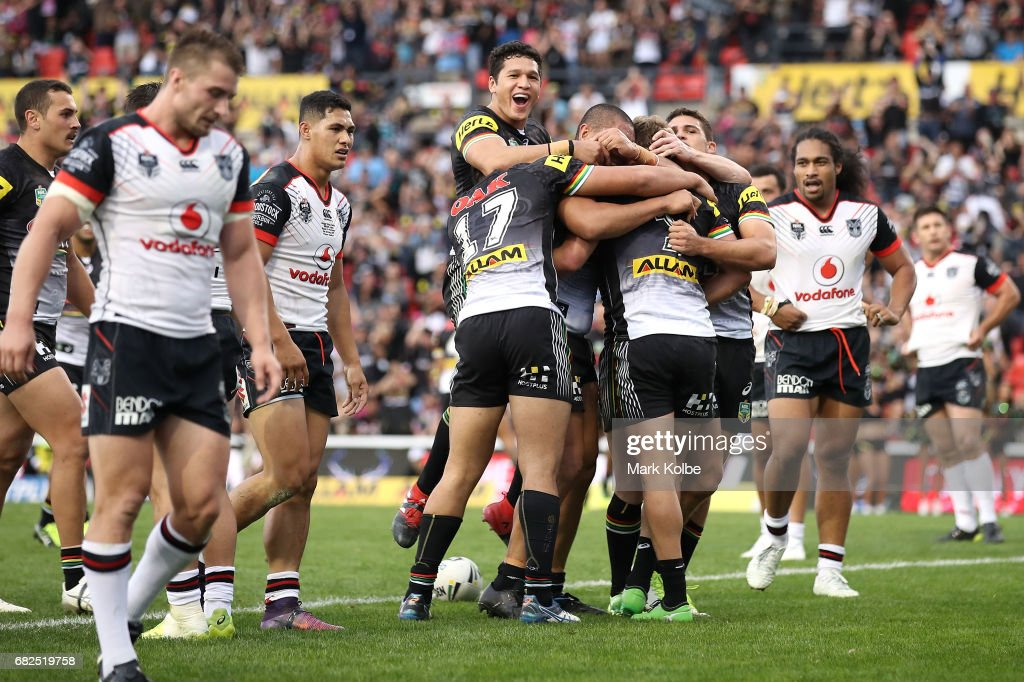 Matt Moylan of the Panthers celebrates with his team mates after scoring a try during the round 10 NRL match between the Penrith Panthers and the New Zealand Warriors at Pepper Stadium on May 13, 2017 in Sydney, Australia.