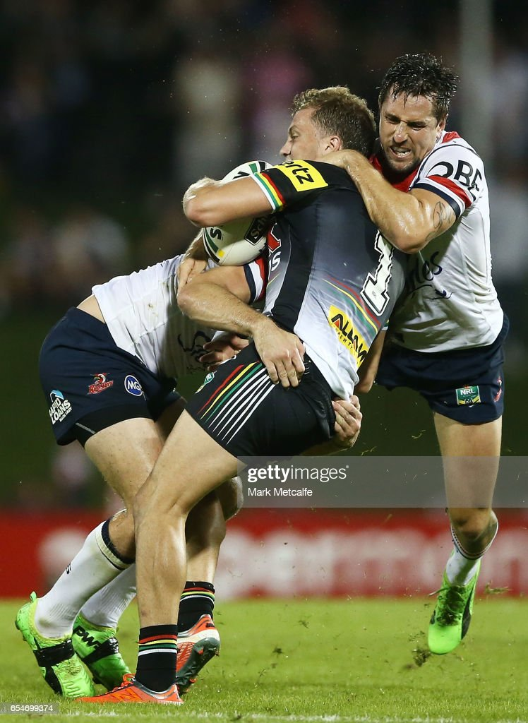 Matt Moylan of the Panthers is tackled by Mitchell Pearce of the Roosters during the round three NRL match between the Penrith Panthers and the Sydney Roosters at Pepper Stadium on March 18, 2017 in Sydney, Australia.