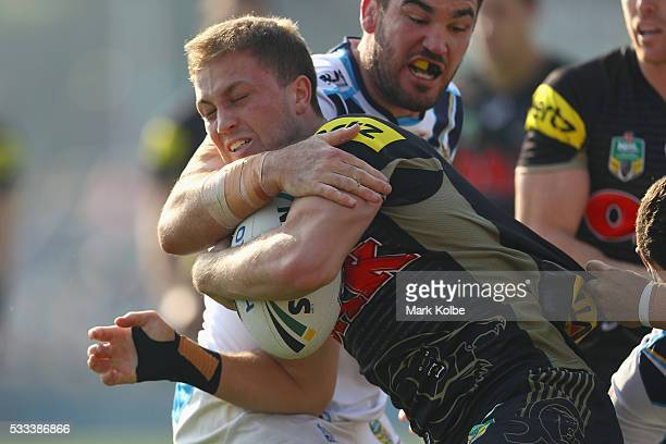 Matt Moylan of the Panthers is tackled during the round 11 NRL match between the Penrith Panthers and the Gold Coast Titans at Pepper Stadium on May...