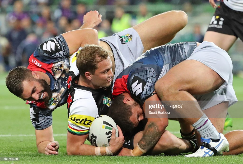 Matt Moylan of the Panthers is tackled during the round five NRL match between the Melbourne Storm and the Penrith Panthers at AAMI Park on April 1, 2017 in Melbourne, Australia.