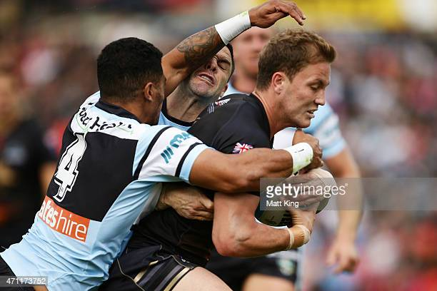 Matt Moylan of the Panthers is tackled just before the line during the round eight NRL match between the Penrith Panthers and the Cronulla Sharks at...
