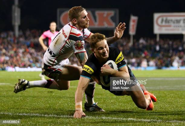 Matt Moylan of the Panthers scores a try during the round 26 NRL match between the Penrith Panthers and the New Zealand Warriors at Sportingbet...