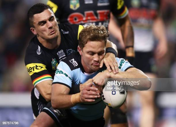 Matt Moylan of the Sharks beats the defence to score a try during the round 18 NRL match between the Panthers and the Sharks at Panthers Stadium on...