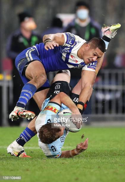 Matt Moylan of the Sharks is tackled Dallin WateneZelezniak of the Bulldogs during the round six NRL match between the Cronulla Sharks and the...