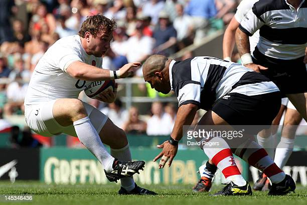 Matt Mullan of England is tackled by John Afoa of The Barbarians during the Killik Cup match between England and The Barbarians at Twickenham Stadium...