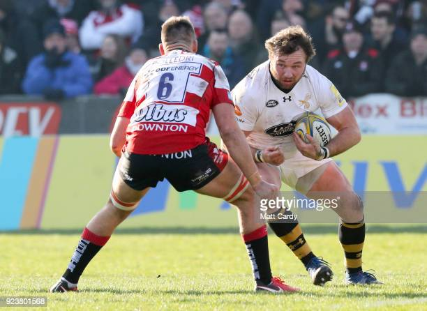 Matt Mullan of Wasps is tackled by Jake Polledri of Gloucester during the Aviva Premiership match between Gloucester Rugby and Wasps at Kingsholm...