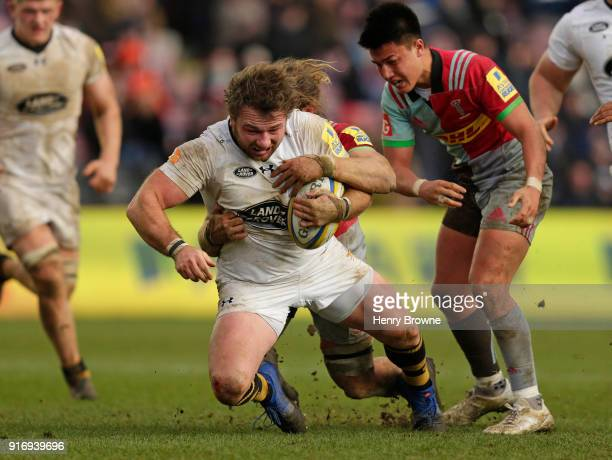 Matt Mullan of Wasps tackled by Luke Wallace of Harlequins during the Aviva Premiership match between Harlequins and Wasps at Twickenham Stoop on...