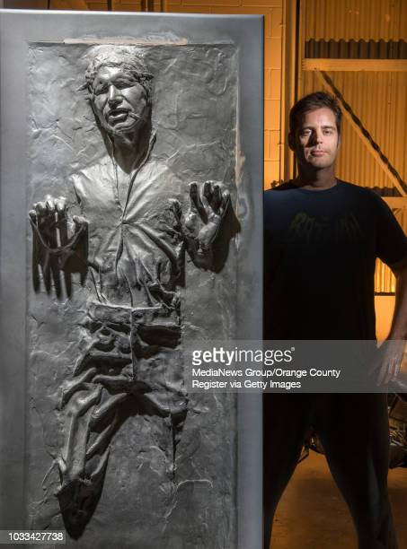 """Matt Munson of Irvine is shown next to a life-sized cast of Hans Solo in carbonite from the Star Wars movie, """"The Empire Strikes Back."""" Munson..."""