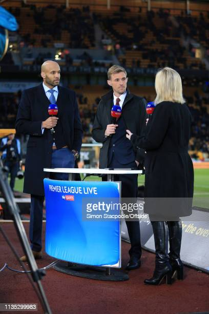 Matt Murray and Darren Fletcher listen to Sky Sports presenter Kelly Cates during the Premier League match between Wolverhampton Wanderers and...