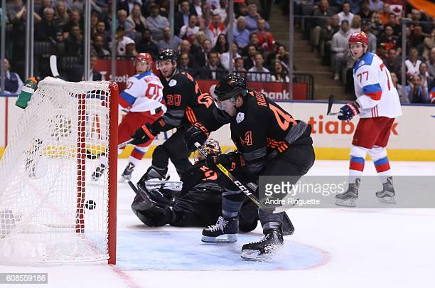 Matt Murray and Morgan Rielly of Team North America dive after the puck as Team Russia scores a second period goal during the World Cup of Hockey...