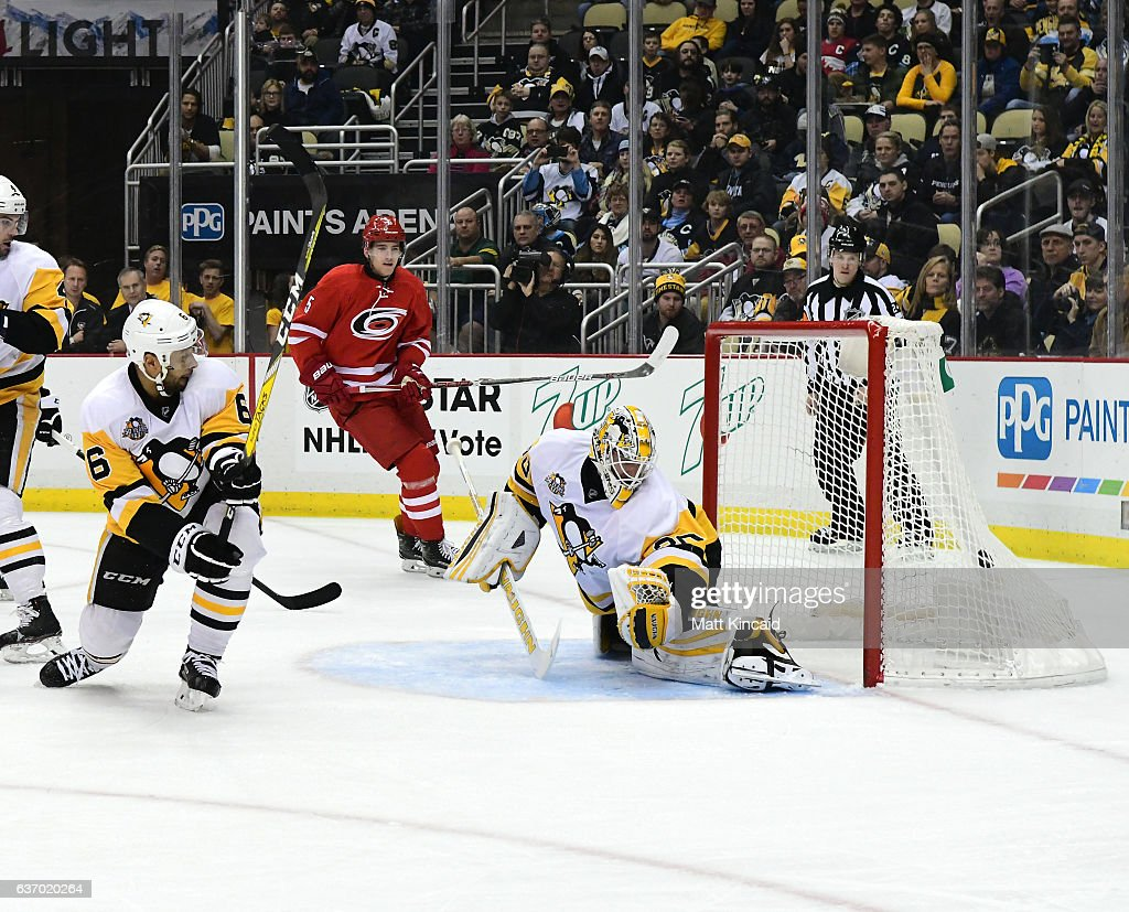 Matt Murray #30 and Trevor Daley #6 of the Pittsburgh Penguins watch the puck go into the net against the Carolina Hurricanes at PPG PAINTS Arena on December 28, 2016 in Pittsburgh, Pennsylvania.