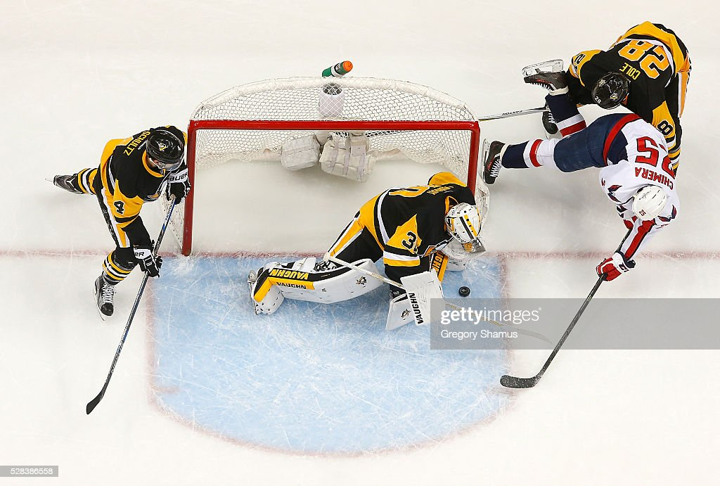 Matt Murray #30 makes a save on a shot by Jason Chimera #25 of the Washington Capitals in front of Ian Cole #28 of the Pittsburgh Penguins in Game Four of the Eastern Conference Second Round during the 2016 NHL Stanley Cup Playoffs at Consol Energy Center on May 2, 2016 in Pittsburgh, Pennsylvania.
