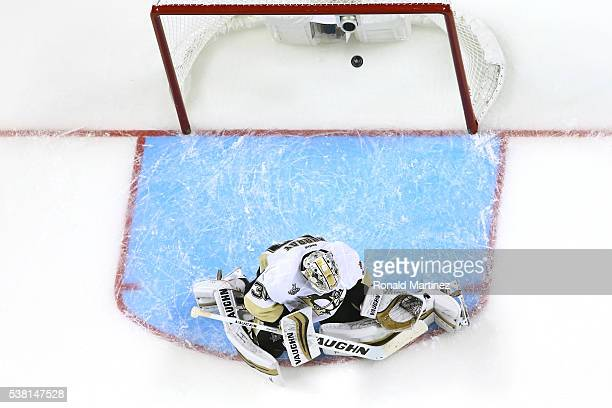 Matt Murray of the Pittsburgh Penguins allows a goal to Joel Ward of the San Jose Sharks during the third period in Game Three of the 2016 NHL...