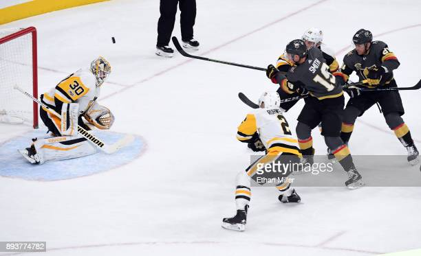Matt Murray of the Pittsburgh Penguins blocks a shot by Reilly Smith of the Vegas Golden Knights in the first period of their game at TMobile Arena...