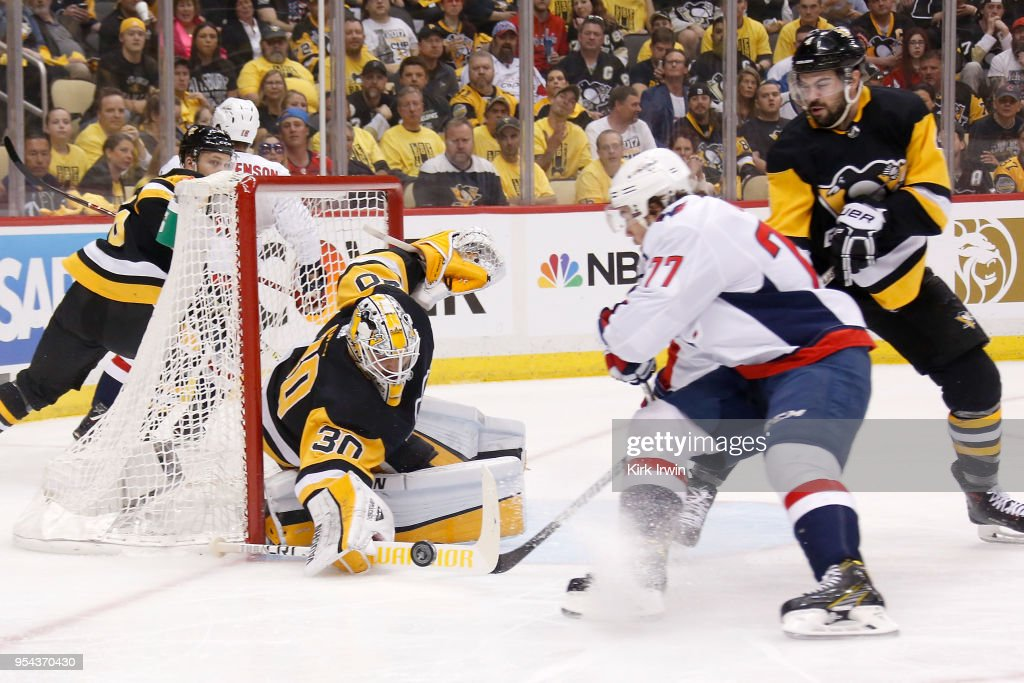 Matt Murray #30 of the Pittsburgh Penguins blocks a shot from T.J. Oshie #77 of the Washington Capitals as Justin Schultz #4 of the Pittsburgh Penguins skates back on defense during the first period in Game Four of the Eastern Conference Second Round during the 2018 NHL Stanley Cup Playoffs at PPG PAINTS Arena on May 3, 2018 in Pittsburgh, Pennsylvania.