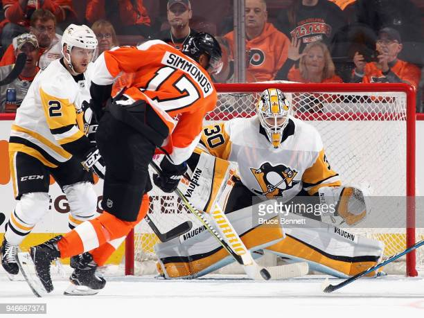 Matt Murray of the Pittsburgh Penguins braces for a shot by Wayne Simmonds of the Philadelphia Flyers during the third period in Game Three of the...