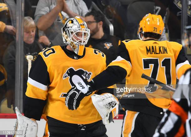 Matt Murray of the Pittsburgh Penguins celebrates with Evgeni Malkin after a 30 win over the Columbus Blue Jackets at PPG Paints Arena on March 7...
