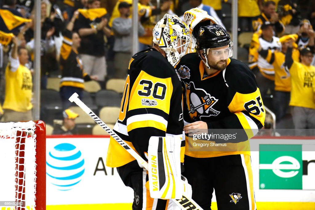 Matt Murray #30 of the Pittsburgh Penguins celebrates with his teammate Ron Hainsey #65 after defeating the Ottawa Senators with a score of 7 to 0 in Game Five of the Eastern Conference Final during the 2017 NHL Stanley Cup Playoffs at PPG PAINTS Arena on May 21, 2017 in Pittsburgh, Pennsylvania.