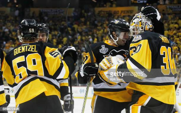 Matt Murray of the Pittsburgh Penguins celebrates with Matt Cullen at the conclusion of the Pittsburgh Penguins 53 win over the Nashville Predators...