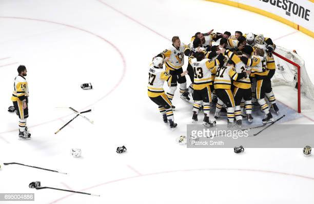 Matt Murray of the Pittsburgh Penguins celebrates with teammates after they defeated the Nashville Predators 2-0 to win the 2017 NHL Stanley Cup...