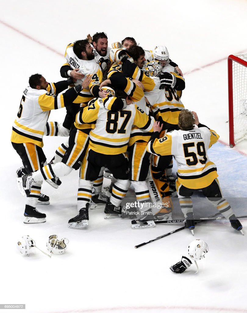 8aa1280dd Matt Murray of the Pittsburgh Penguins celebrates with teammates ...