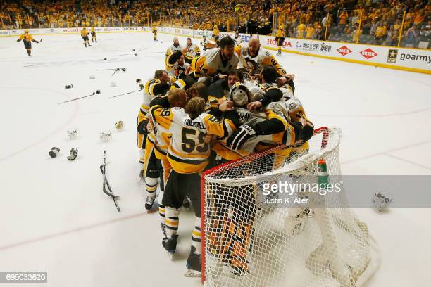 Matt Murray of the Pittsburgh Penguins celebrates with teammates after defeating the Nashville Predators 2-0 to win the 2017 NHL Stanley Cup Final at...