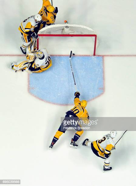 Matt Murray of the Pittsburgh Penguins defends the goal as Colton Sissons of the Nashville Predators reachs for the puck during the second period in...