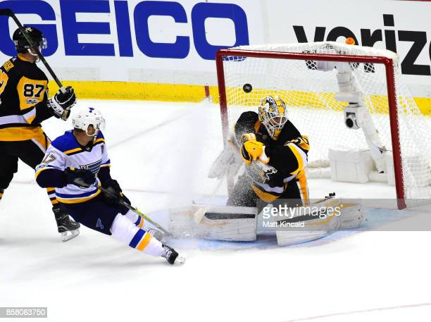 Matt Murray of the Pittsburgh Penguins has the game winning goal in overtime go past him as Jaden Schwartz of the St Louis Blues looks on at PPG...