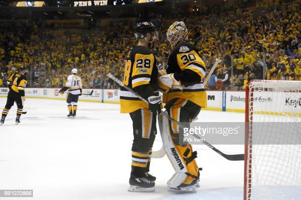Matt Murray of the Pittsburgh Penguins hugs Ian Cole at the conclusion of the Pittsburgh Penguins 41 win over the Nashville Predators in Game Two of...