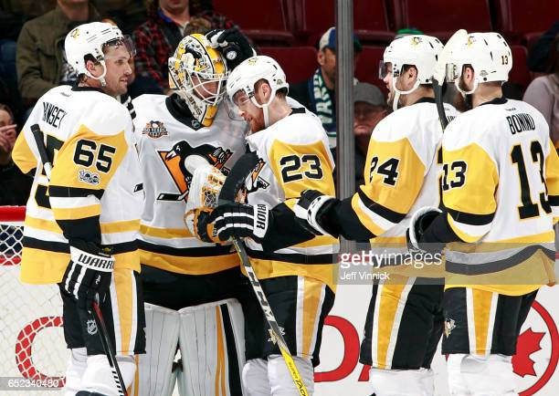 Matt Murray of the Pittsburgh Penguins is congratulated by teammates Ron Hainsey and Scott Wilson after their NHL game against the Vancouver Canucks...