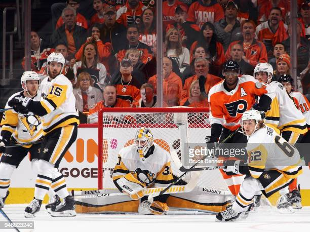 Matt Murray of the Pittsburgh Penguins keeps his eyes on the play during the first period against the Philadelphia Flyers in Game Three of the...