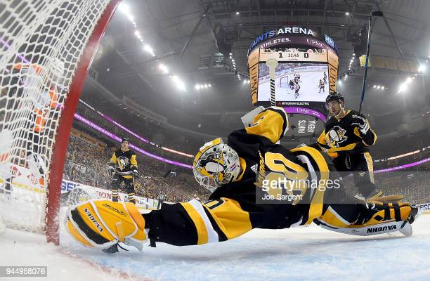 Matt Murray of the Pittsburgh Penguins makes a diving save against Scott Laughton of the Philadelphia Flyers in Game One of the Eastern Conference...