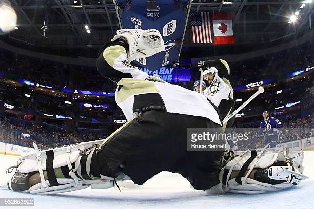 Matt Murray of the Pittsburgh Penguins makes a glove save against the Tampa Bay Lightning against the Tampa Bay Lightning in Game Three of the...