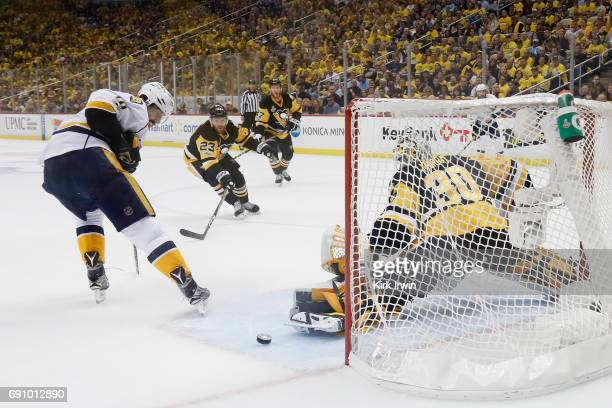 Matt Murray of the Pittsburgh Penguins makes a save against James Neal of the Nashville Predators during the first period in Game Two of the 2017 NHL...