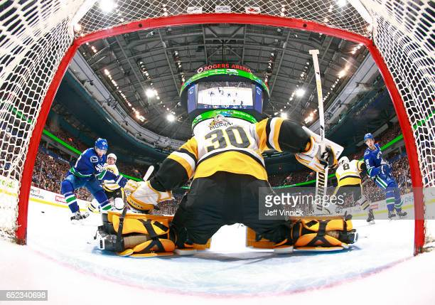 Matt Murray of the Pittsburgh Penguins makes a save against Jayson Megna of the Vancouver Canucks during their NHL game at Rogers Arena March 11,...