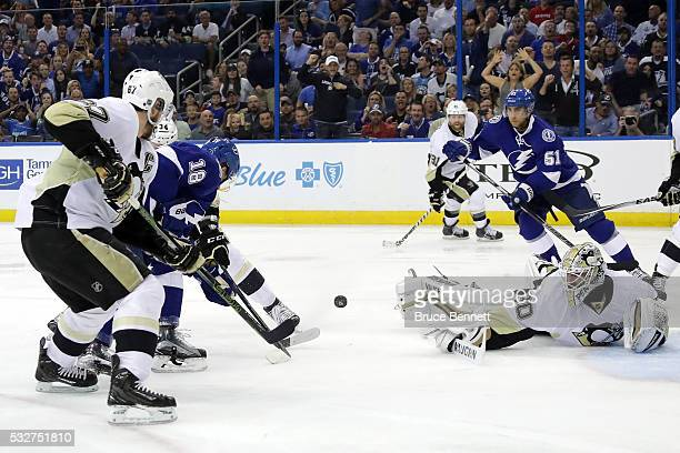 Matt Murray of the Pittsburgh Penguins makes a save against Ondrej Palat of the Tampa Bay Lightning during the second period in Game Three of the...